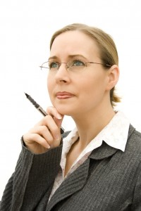 Woman looking into distance whilst thinking